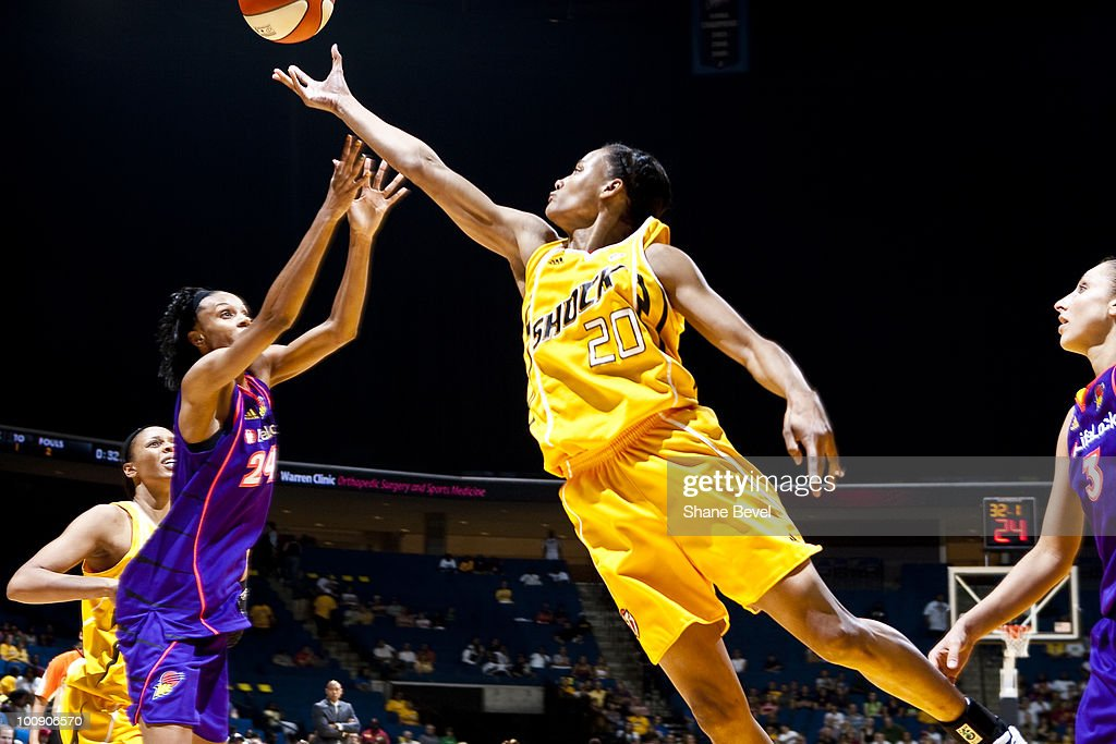 Marion Jones #20 of the Tulsa Shock reaches for a rebound during the WNBA game on May 25, 2010 at the BOK Center in Tulsa, Oklahoma.