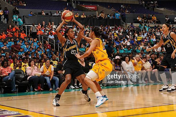 Marion Jones of the Tulsa Shock tries to pass above the Los Angeles Sparks during the WNBA game on July 20 2010 at Staples Center in Los Angeles...