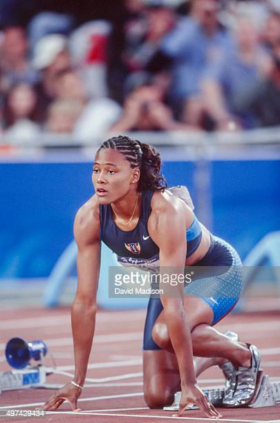 Marion Jones of the USA prepares to run in the semi final of the Women's 100 meter event of the 2000 Summer Olympics track and field competition held...