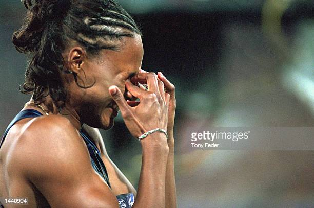 Marion Jones of the USA reacts emotionally after winning the gold medal in the women's 100m final at the Olympic Stadium during the Summer Olympic...