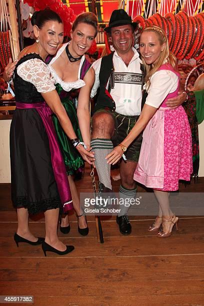 Marion Kiechle Julia Scharf and Katja Wunderlich attend the 'Sixt Damen Wiesn' at Marstall tent during Oktoberfest at Theresienwiese on September 22...