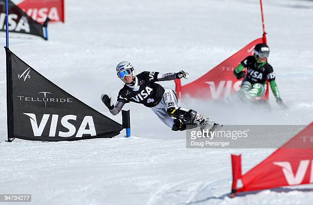 Marion Kreiner of Austria races Isabella Laboeck of Germany in the FIS Snowboard Parallel Giant Slalom World Cup on December 17 2009 in Telluride...