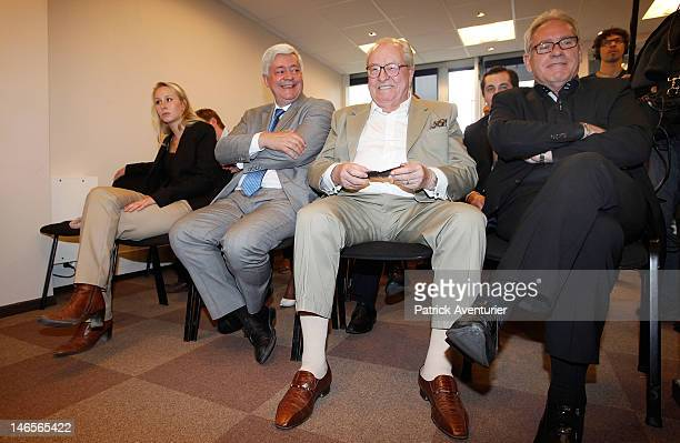 Marion MarechalLe Pen sits next to Bruno Gollnisch and her grandfather JeanMarie Le Pen during the press conference of the National Front on June 19...