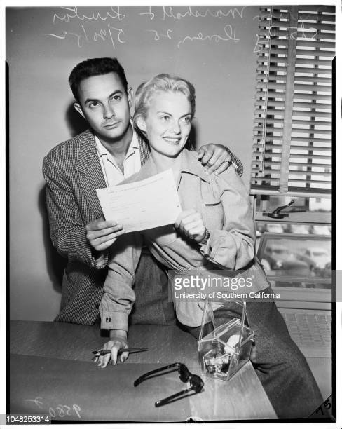 Marion Marshall gets wedding license 20 May 1952 Actress Marion MarshallStanley Donen 28 years Caption slip reads 'Photographer Gaze Date Reporter...