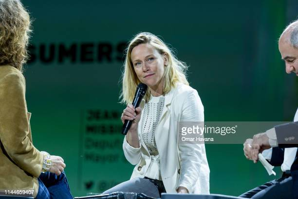 Marion Moreau Head of SIGFOX Foundation speaks to attendees during a plenary session during the Sustainable Brands Paris conference in the Carrousel...