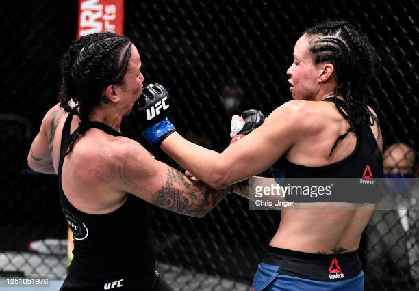 Marion Reneau and Raquel Pennington trade punches in their bantamweight bout during the UFC Fight Night event at UFC APEX on June 20 2020 in Las...