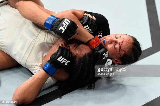 Marion Reneau attempts to submit Talita Bernardo of Brazil in their women's bantamweight bout during the UFC Fight Night event at the Rotterdam Ahoy...