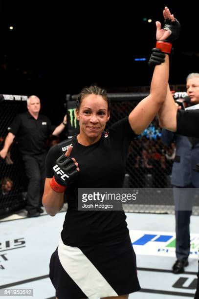 Marion Reneau celebrates after defeating Talita Bernardo of Brazil by TKO in their women's bantamweight bout during the UFC Fight Night event at the...