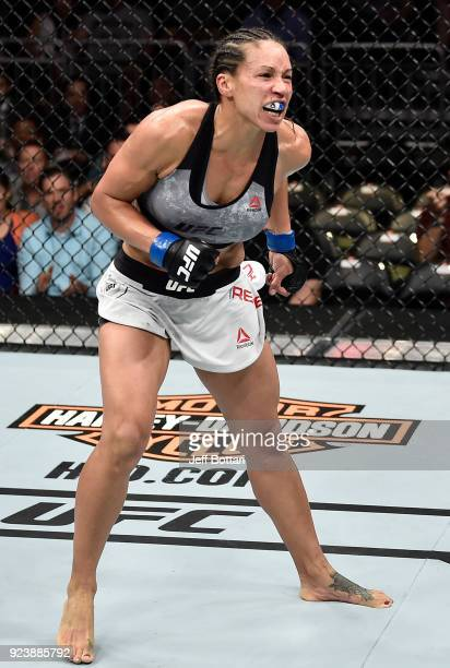 Marion Reneau celebrates after her submission victory over Sara McMann in their women's bantamweight bout during the UFC Fight Night event at Amway...