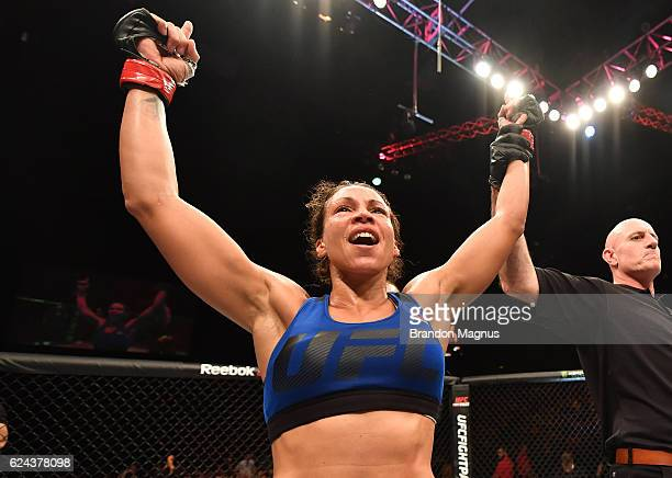 Marion Reneau celebrates after her TKO victory over Milana Dudieva of Russia in their women's bantamweight bout during the UFC Fight Night at the SSE...