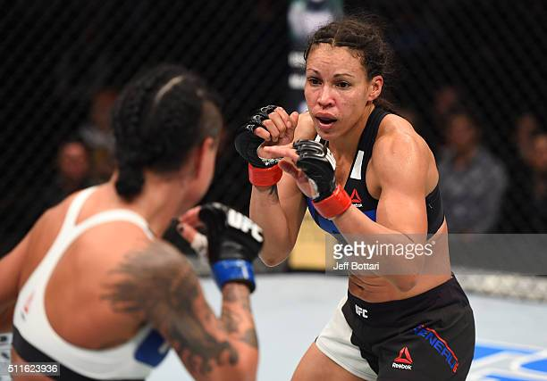 Marion Reneau circles Ashlee EvansSmith in their women's bantamweight bout during the UFC Fight Night event at Consol Energy Center on February 21...
