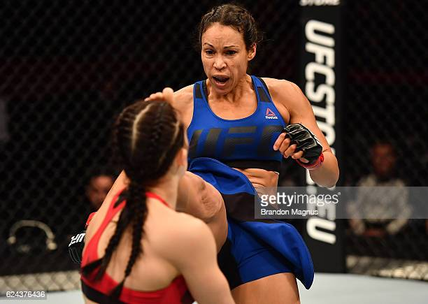Marion Reneau kicks Milana Dudieva of Russia in their women's bantamweight bout during the UFC Fight Night at the SSE Arena on November 19 2016 in...