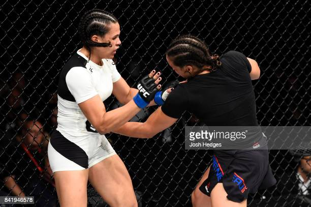 Marion Reneau lands a punch to the body of Talita Bernardo of Brazil in their women's bantamweight bout during the UFC Fight Night event at the...