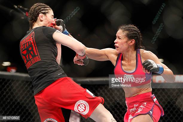 Marion Reneau punches Alexis Dufresne in their women's bantamweight bout during the UFC 182 event at the MGM Grand Garden Arena on January 3 2015 in...