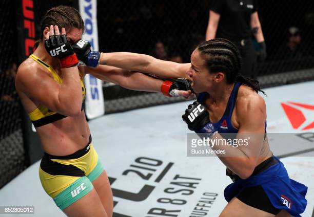 Marion Reneau punches Bethe Correia of Brazil in their women's bantamweight bout during the UFC Fight Night event at CFO Centro de Formaco Olimpica...