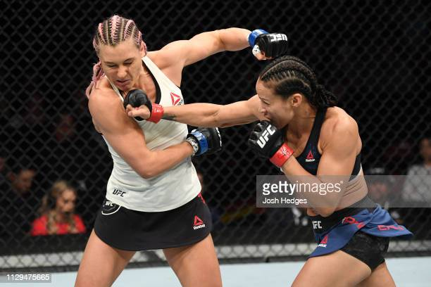 Marion Reneau punches Yana Kunitskaya of Russia in their women's bantamweight bout during the UFC Fight Night event at Intrust Bank Arena on March 9...