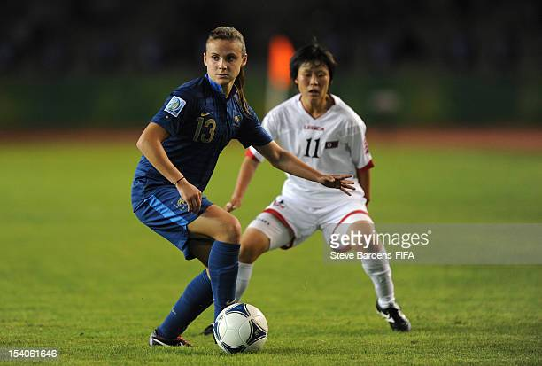 Marion Romanelli of France holds of Phyong Hwa Kim of Korea DPR during the FIFA U17 Women's World Cup 2012 Final between France and Korea DPR at the...