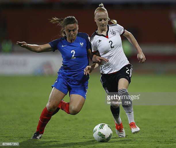 Marion Romanelli of France tries to tackle Anna Gerhardt of Germany during the FIFA U20 Women's World Cup Quarter Final match between Germany and...
