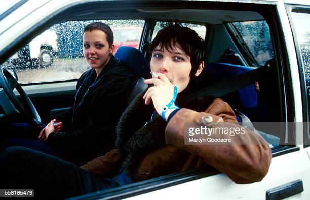 Marion singer Jaime Harding backstage in a car at Glastonbury Festival, United Kingdom, 1999.