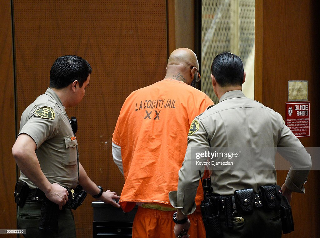 Marion 'Suge' Knight (C) escorted by Los Angeles Sheriff Deputies after appearing for a hearing at the Clara Shortridge Foltz Criminal Justice Center March 9, 2015 in Los Angeles, California. The hearing was scheduled to determine if the two criminal cases against Knight, one for murder and attempted murder when Knight allegedly ran over two men in a Compton parking lot after an argument and another case involving an alleged robbery and criminal threats to a photographer in Beverly Hills, should be moved to the downtown Los Angeles courthouse.