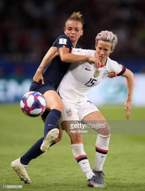 Marion Torrent of France battles for possession with Megan Rapinoe of the USA during the 2019 FIFA Women's World Cup France Quarter Final match...