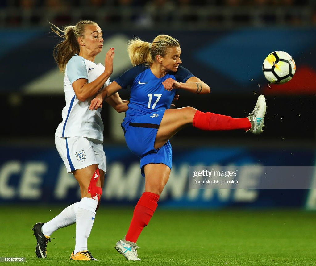 Marion Torrent of France battles for the ball with Toni Duggan of England during the International friendly match between France and Women held at Stade du Hainaut on October 20, 2017 in Valenciennes, France.
