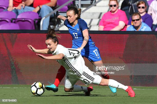 Marion Torrent of France pushes Lina Magull of Germany during the SheBelieves Cup soccer match at Orlando City Stadium on March 7 2018 in Orlando...