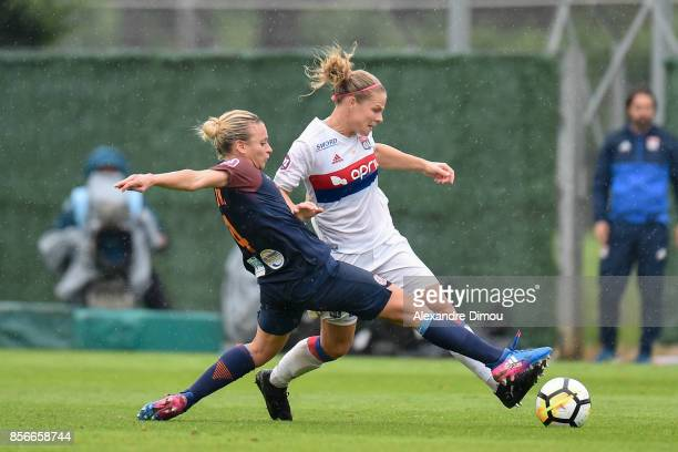 Marion Torrent of Montpellier and Eugenie Le Sommer of Lyon during the women's Division 1 match between Montpellier and Lyon on September 30 2017 in...