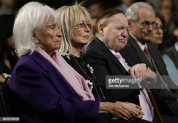 Marion Wiesel Miriam Adelson and American businessman Sheldon Adelson listen to speakers during a roundtable discussion on Capitol Hill March 2 2015...