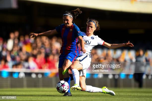 Mariona Caldentey of FC Barcelona competes for the ball with Irene Paredes of Paris Saint-Germain during the UEFA Women's Champions League first leg...