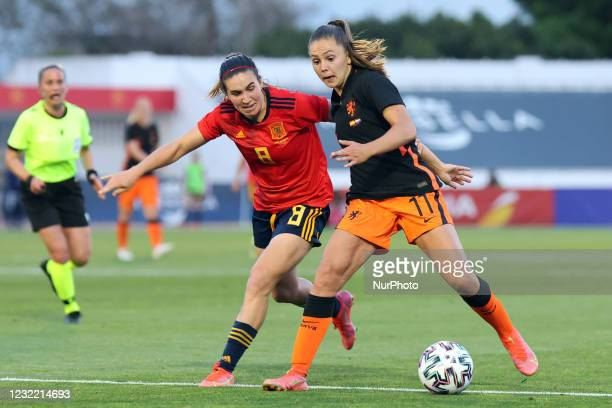 Mariona Caldetey of Spain in action with Lieke Martens ouring the International Friendly Women match between Spain v Netherlands at the Estadio...