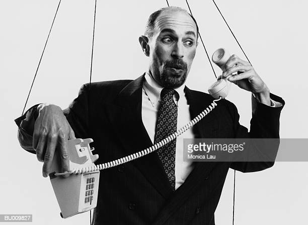 Marionette Businessman with Telephone