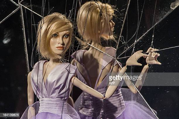 Marionettes present creations by Fause Haten during the Sao Paulo Fashion Week in Sao Paulo 2013 Summer collections in Sao Paulo Brazil on March 20...