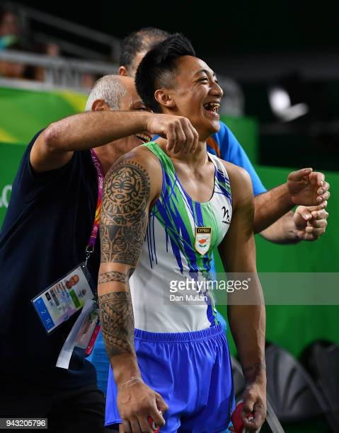 Marios Georgiou of Cyprus celebrates victory with his coaching teamduring Gymnastics Men's Floor Final on day four of the Gold Coast 2018...