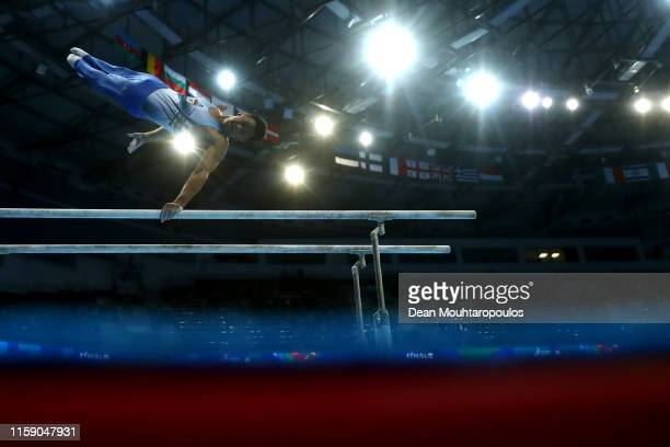 Marios Georgiou of Cyprus competes on the Parallel bars during the Artistic Gymnastics Men's AllAround Finals event during Day nine of the 2nd...