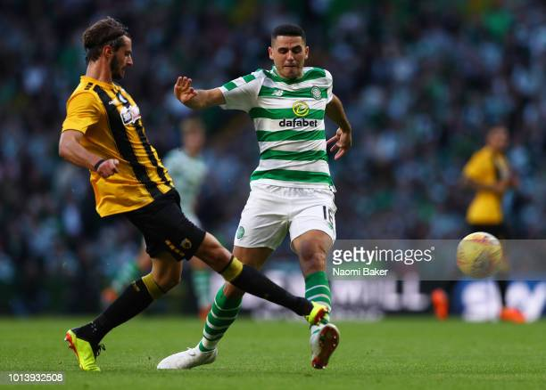 Marios Oikonomou of AEK Athens battles for posession with Tom Rogic of Celtic during the UEFA Champions League Qualifiing match between Celtic and...