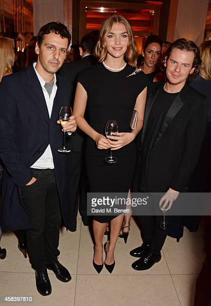 Marios Schwab, Arizona Muse and Christopher Kane attend the Harper's Bazaar Women Of The Year awards 2014 at Claridge's Hotel on November 4, 2014 in...
