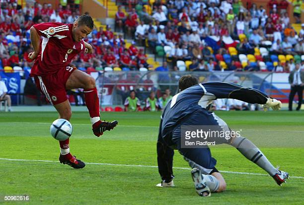 Maris Verpakovskis of Latvia scores their first goal as Petr Cech looks on during the UEFA Euro 2004 Group D match between Czech Republic and Latvia...