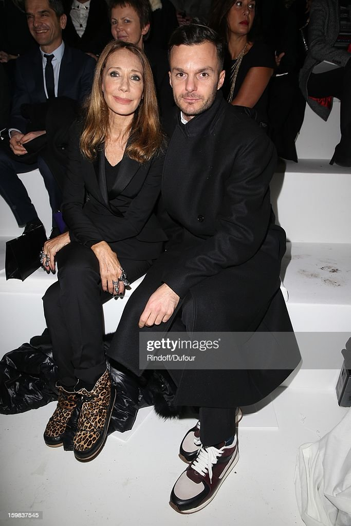 Marisa Berenson and Kriss Van Assche attend the Christian Dior Spring/Summer 2013 Haute-Couture show as part of Paris Fashion Week at on January 21, 2013 in Paris, France.