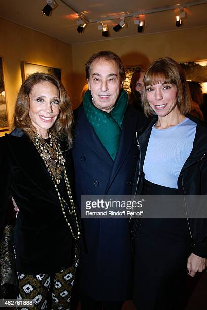 Marisa Berenson Gilles Dufour and Mathilde Favier attend the Patrice Calmettes Exhibition at Galerie Passebon on February 4 2015 in Paris France