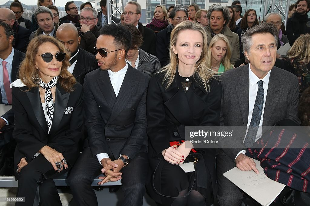 Marisa Berenson, Lewis Hamilton, Delphine Arnault and Brian Ferry attend the Louis Vuitton Menswear Fall/Winter 2015-2016 Show as part of Paris Fashion Week on January 22, 2015 in Paris, France.