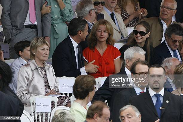 Marisa Bruni Tedeschi, Francois Sarkozy and his wife, Consuelo Remmert in Paris, France on July 14th, 2010.
