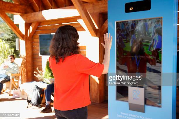 Marisa de Belloy CEO of nonprofit Cool Effect engages with the Carbon Vision Mirror at Dreamforce on November 7 2017 in San Francisco California...