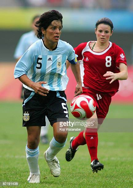 Marisa Gerez of Argentina and Diana Matheson of Canada and Guadalupe Calello of Argentina compete for the ball during the Women's Group E match...
