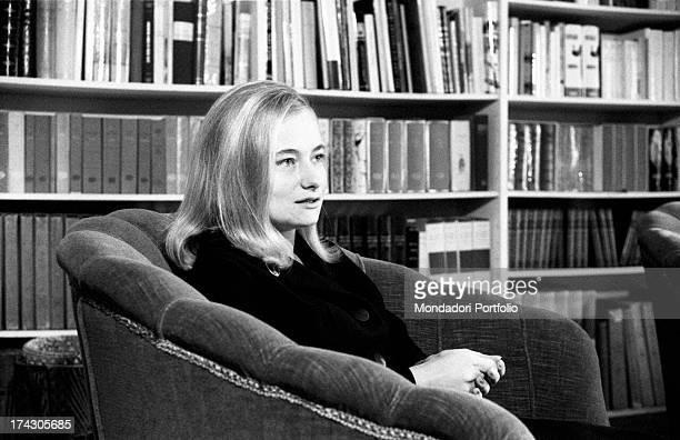 Marisa Malagoli Togliatti sitting on an armchair. Marisa is Palmiro Togliatti and Nilde Iotti's adopted daughter. Rome, 1964.
