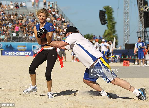 Marisa Miller is tackled by Tom Arnold at the Fourth Annual DIRECTV Celebrity Beach Bowl at DIRECTV Celebrity Beach Bowl Stadium South Beach on...