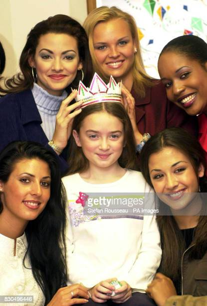 Marisa Reid aged nine from Sussex with Miss World contestants who were presenting a cake to The Variety Club Childrens Hospital at Kings College...