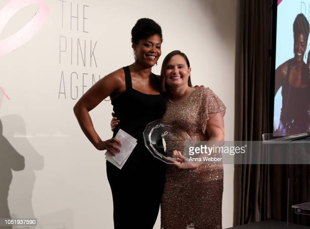 Marisa Renee Lee and Rebecca Hall speak onstage at The Pink Agenda's Annual Gala at Tribeca Rooftop on October 11 2018 in New York City