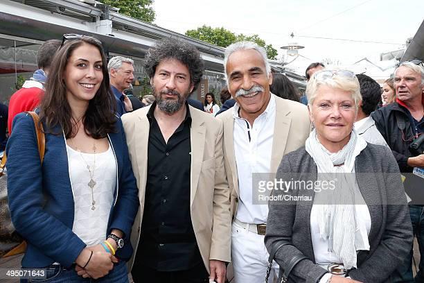 Marisa Tulliot director Radu Mihaileanu former tennis player Mansour Bahrami and his wife Veronique attend the Roland Garros French Tennis Open 2014...