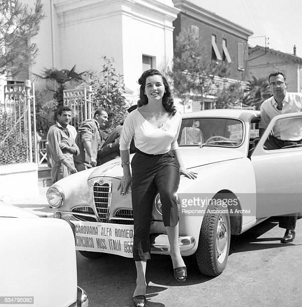 Marisa Zocchi Miss Toscana '55 posing next to an Alfa Romeo 1900 Italy 1955